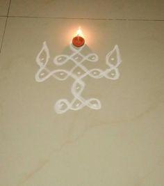 A very simple Deepam Kolam, drawn with dots, just kept diya or Vellaku to my simple dots kolam. I have shared,. Indian Rangoli Designs, Simple Rangoli Designs Images, Rangoli Border Designs, Rangoli Designs With Dots, Rangoli With Dots, Beautiful Rangoli Designs, Rangoli Patterns, Rangoli Ideas, Kolam Rangoli