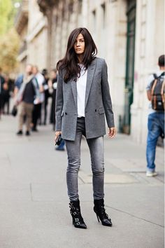 A gray blazer is worn with gray denim, a white tee and black boots.