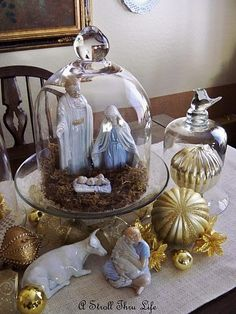 The specific nativity set isn't my favorite, but I like the idea of putting it under a glass cloche.