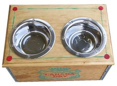 Elevated dog feeder with storage. Re-purposed from vintage Canada Dry beverage wooden crate. Hand painted hinged lid for easy access storage. Stainless steel food and water bowls. Free UPS delivery.   For Love of a Dog