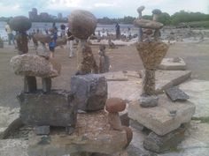 Balanced rock sculpture art displayed every summer along the Ottawa River. For more information on Ottawa visit www.ottawatourism.ca