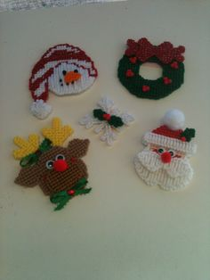 Plastic Canvas Christmas Magnets.