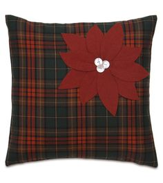 POINSETTIA PLAID  Go Scotch this holiday season with Poinsettia Plaid! With vibrant Christmas-red cutouts decoratively stitched onto a warm plaid face, this seasonal pillow is also a great gift idea.  Pillow features:  Buttons and stitched fabric cut outs on face  Self-backed  Fully lined  Knife edge finishing  Zipper closure  Down pillow insert  Made in the USA  Size	: 20X20
