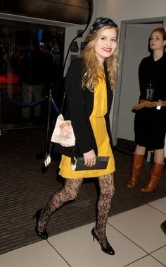 Georgia May Jagger in canary yellow dress and black lace tights