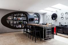 Fashionable Accessory Decoration For Making Interior Design More Innovative : Kitchen Design In House With Several Tall Black Wooden Bar Stool And Silver Colored Table Made From Wooden Surface Black Kitchen Island Floating Lcd Tv Cabinet For Accessories