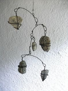 Beach stone Mobile by CharestStudios, oh wouldn't this be great in my hall bath? Mobiles, Wire Crafts, Rock Crafts, Art Plastic, Sculpture Metal, Kinetic Art, Sticks And Stones, Beach Stones, Nature Crafts