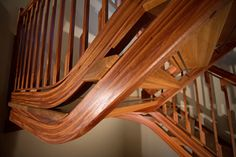 """Here is another amazing staircase that is designed and made by NK Woodworking based out of Seattle. The Project is """"Straight Curves"""". Material used include Sapele and White Oak. East Teak provided the lumber used in Sapele stringers, and balustrade (railings). The textures in the Sapele and really brought out in their amazing work. I…"""