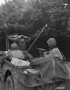 Two German prisoners of war are being taken to the Division Prisoner of War Encampment for interrogation and searching. There were 218 captured by the Free French Infantry and Armored Division troops in Plouay - north of Lorient Brittany France 28 August Free In French, Ww2 Photos, Jeep Photos, Photographs, Luftwaffe, History Online, Prisoners Of War, French Army, American Soldiers