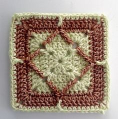 Crocheted square that can be worked in any yarn and used for blankets or throws.