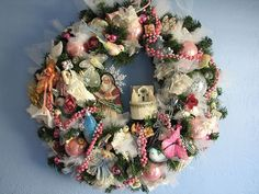 shabby chic    tulle and flowers from an old hat, pink balls and birds and snowmen...