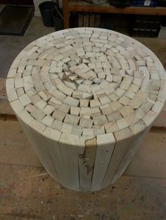 Side table made from reclaimed pallet slats individually fitted on the outside through to a plywood inner ring. Hand cut central pieces tapped into place.