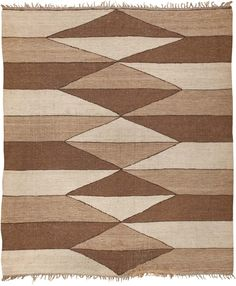 Kilim, Morocco, circa mid 20th century | This rug features an accordion stripe pattern rendered in a triad of neutral shades. Light, mid, and dark value colors create an illusion of depth along with mountains and valleys tucked in the simple stripe pattern