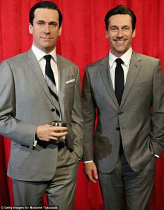 Actor Jon Hamm poses with wax copy of Don Draper - Spot the difference: The two do look very similiar in their matching grey suits  - May 2014