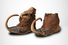 Appear to be leather and fabric ankle boots from Central Asia with Iranic and Mongol influences. While the Sogdians, the great traders of Central Asia, were renown for their curved pointed shoes, these are likely newer.