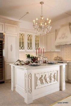 | A Kitchen Island with a frieze like the Are Pacis Augustae or the Parthenon! |