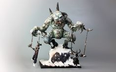 A grotesque Warhammer warband of extensively converted giant ice trolls from the frozen North, created by Julian Bayliss