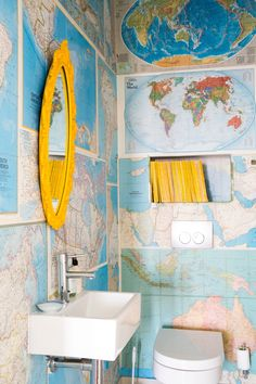 Vicki has been collecting National Geographic magazines for over ten years. She collated all the maps and created the DIY wallpaper for their guest loo. The mirror in the perfect matching yellow is from Vamp. Bathroom Wallpaper Diy, Map Wallpaper, Yellow Mirrors, Yellow Walls, Diy Tapete, Yellow Bathrooms, Vintage Bathrooms, Paper Houses, Deco Design