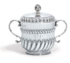 A WILLIAM AND MARY SILVER PORRINGER, LONDON 1691.