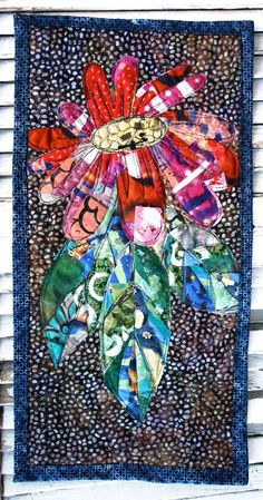 mixed media art quilt with black & white dots, red and aqua flowers