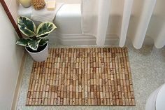 Wine Cork Bathmat http://www.econesting.com/2010/06/12/make-a-wine-cork-bath-mat-a-treat-for-your-feet/