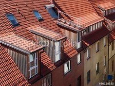 Dachgauben und Mansarden auf rotbraunem Ziegeldach in Bielefeld in Ostwestfalen-Lippe