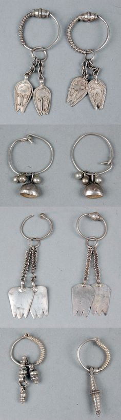 Oman | Hoop earrings ~ halqa or hilqa ~ silver. ca. 1950s | Usually worn by women (and girls) in the north of Oman || Museum No: 2012,6010.19.a-b; 2012,6010.21.a-b; 2012,6010.18.a-d and 2012,6010.20.a-b