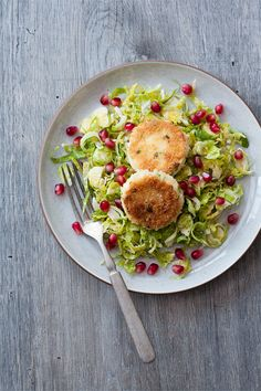 Shaved Brussels Sprout Salad with Pan-Fried Goat Cheese and Pomegranate | loveandoliveoil.com @Lindsay (Love & Olive Oil) #salad #healthy #recipe #brusselssprout #mostlyavailable