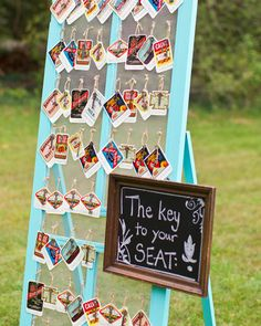 """A painted screen door was used to display the escort cards. To create them, old labels with guests' names were mounted to card stock and skeleton keys were tied on with twine. Guests found the """"key to their seat"""" before entering the dinner tent."""