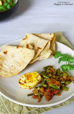 Asparagus, Green Peas And Egg Masala. Try asparagus in an Indian avatar in a simple egg masala dish. Perfect for sopping up with some naans or chapatis.  #happyandharried #egg #masala #curry #roast #Indian #asparagus #peas #dinner #recipe #easy