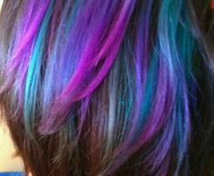 Layer turquoise and plum tones together to create this gorgeous hair color.