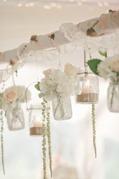 hanging votives and flowers - photo by Vicki Bartel Photography http://ruffledblog.com/pastel-ontario-wedding-at-sprucewood-shores