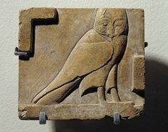 Ancient Egyptian limestone relief portraying an owl; the owl represented the ancient Egyptian hieroglyph signifying 'M'. (Louvre Museum/Lessing-photo.com)