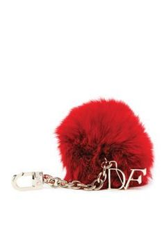 Add a playful edge to any look with the DVF Fur Pom Pom charm in lacquer red.