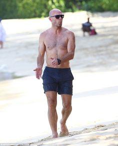 Alan Shearer enjoying the sun on the beach in Barbados
