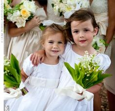 White Flower Girl Dresses and carrying lilly of the valley