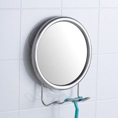 Attractively organize your shower area with our Stainless Steel Fogless Suction Mirror.  Suction cups attach the mirror securely to any smooth, non-porous surface such as tile, glass, fiberglass or metal.  Position the mirror in the shower - it won't get foggy from the steam.  Below are hooks for hanging a razor, toothbrush or scrub brush. Made of rustproof stainless steel.