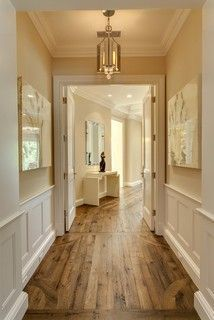 Rustic plank flooring with prestine white wainscoting