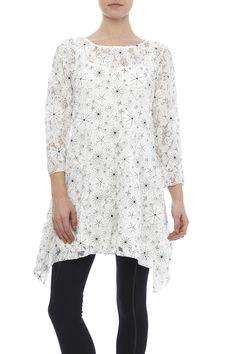 Happy Flower Tunic with 3/4 sleeves, round neckline and shark bite sides. Wear this white tunic with black and white flower detail with black leggings or white shimmer stockings.   Happy Flower Tunic by Scarborough Fair. Clothing - Tops - Long Sleeve Clothing - Tops - Tunics Saint Paul, Minnesota