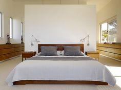 Headboard serves as room divider between bedroom and closet