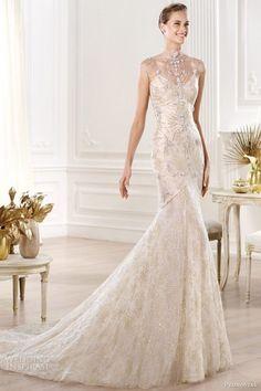 romántico vestido de novia asirenado de encjae con detalles de predrería