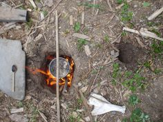 Dakota fire hole for efficient cooking and minimal smoke signature