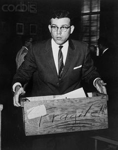 March 24, 1960 - County Attorney Duane West carries from the courtroom evidence introduced  in the trial of Richard Hickock and Perry Smith for the murder of four members of the Herbert  Clutter family near Holcomb, November 15th.