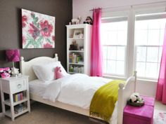 Girls Room Ideas | Go for Attractive Colors and Modern Design...easily changeable as they grow, even with such a dark wall behind, great base to work with as the colours you use for Drapes, Bedding, Rug etc. will pop and be your feature.