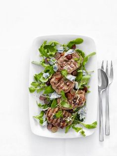 Grilled Pork with Arugula-and-Grape Salad : You use homemade balsamic vinaigrette two ways in this dish: a few tablespoons to marinate the pork chops and the rest to dress the arugula and grape salad.