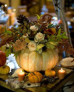 This is a great idea for a fall wedding, but even more so, for a warm and inviting space in our home or the tablescape for Thanksgiving or fall. Too bad they don't say what kind of flowers these are or how to do this.  It looks simple enough.   I can always print this and take it to the florist.  See if they can tell me what flowers these are.