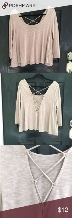 Flowy Crop top/ three quarter length sleeve Super cute crop top with a laced up back detail. Really comfortable and versatile. Good condition! American Eagle Outfitters Tops Crop Tops