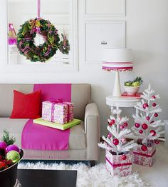 love the use of bright pink in this holiday living room