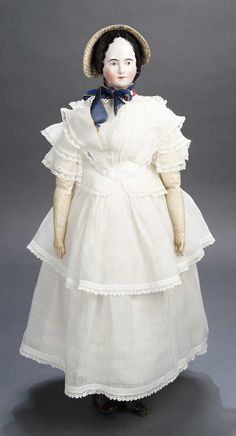 German Porcelain Lady Doll with Extremely Rare Green Eyes, circa 1855, wearing white muslin gown, undergarments, leather slippers and silk sun bonnet.