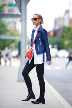Mary Seng is wearing a leather jacket from Parker, white shirt from Alexander Wang, jeans from Denim AG, boots from Prada, bag from Givenchy and the sunglasses are from RayBan