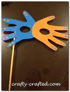 Masquerade mask with 2 handprint cutouts! A fun prop for a cute disguise! #Halloween! #kids #craft